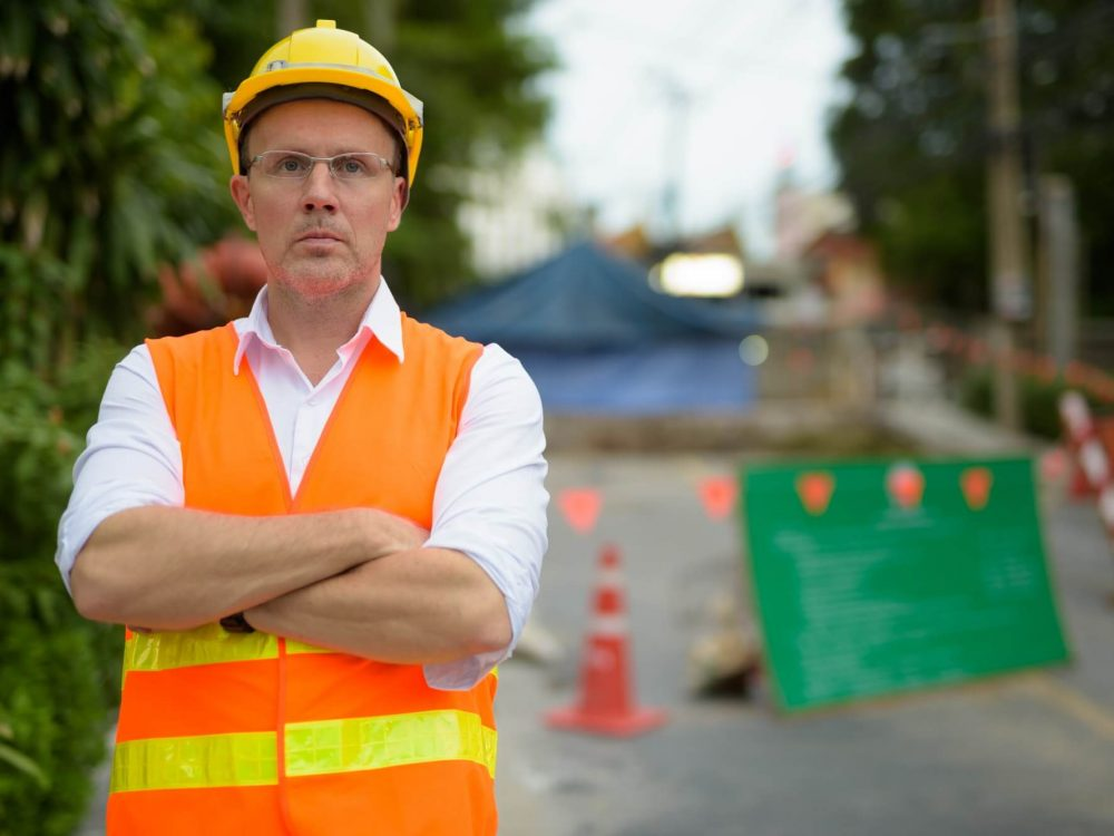 mature-man-construction-worker-at-the-construction-site-in-the-c-2.jpg